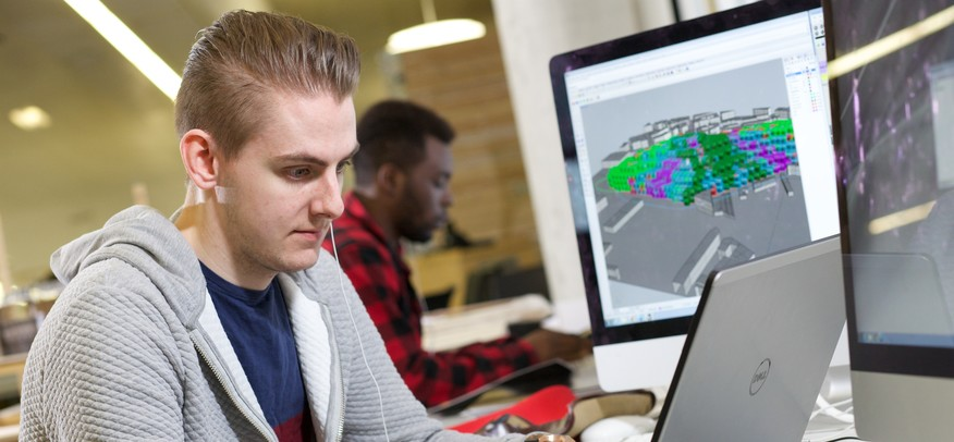 Student in Leeds Beckett Architecture Studios using architecture software