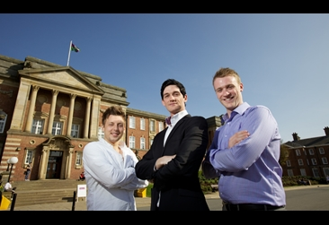 Three men posing for the camera at Headingley campus