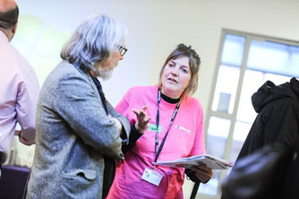 Members of staff talking at the Community Champions fair