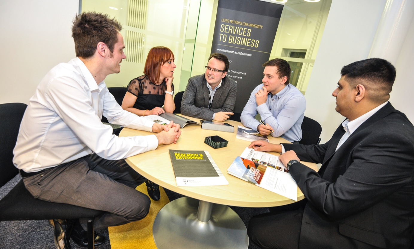 business students around table