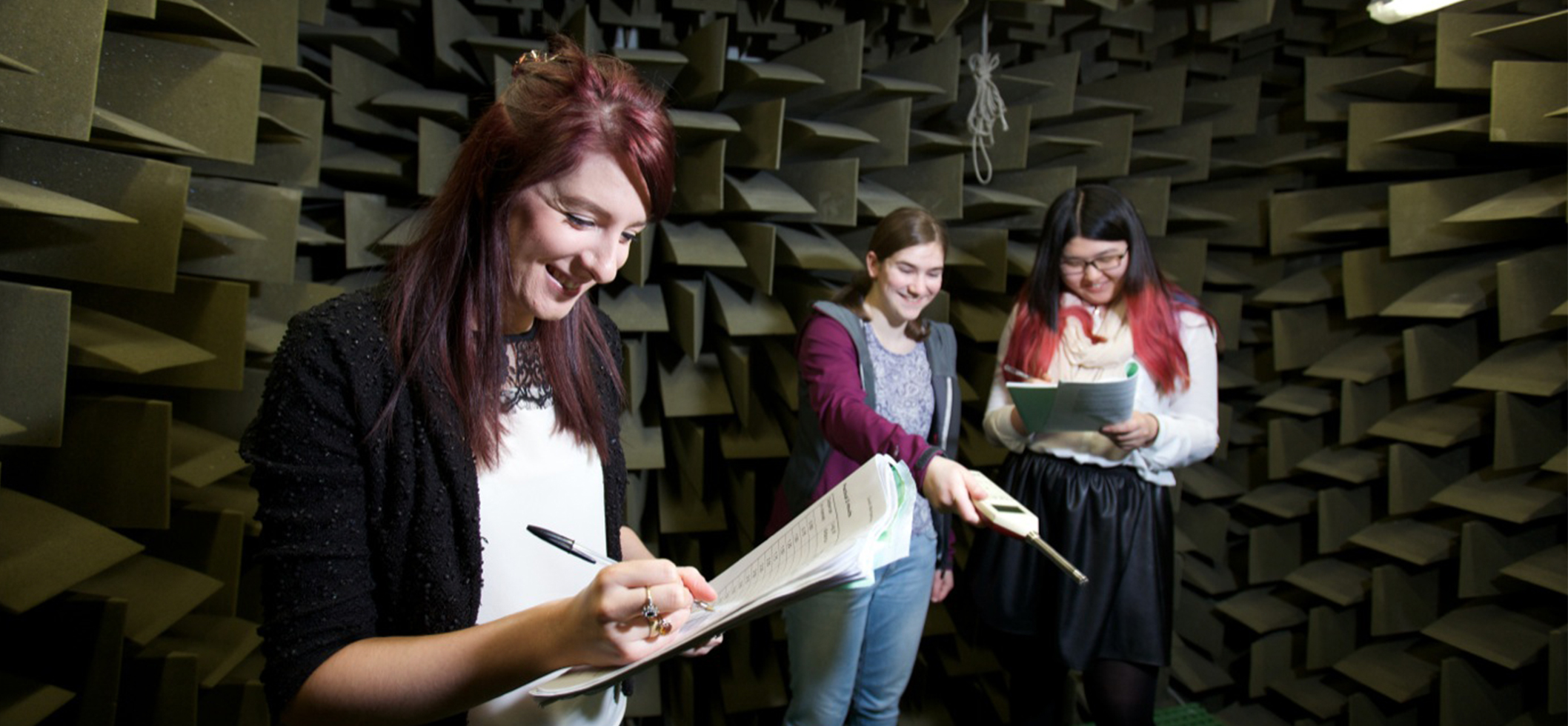 Students working in an acoustic lab