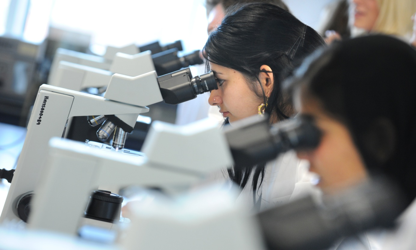 Students looking into microscopes