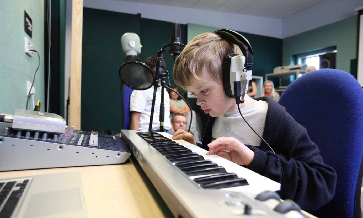 Child in the music studio
