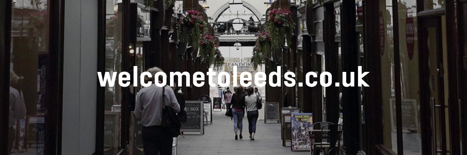 shopping arcade with welcome to leeds branding