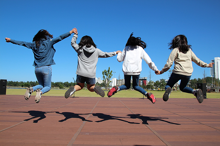 School girls jumping in the playground