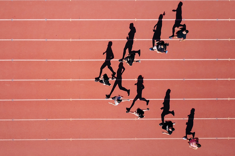 Overhead of image of athletes running on track