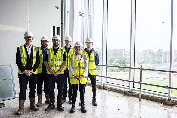 Carnegie School of Sport dean Pete Mackreth with alumni at the new build topping out