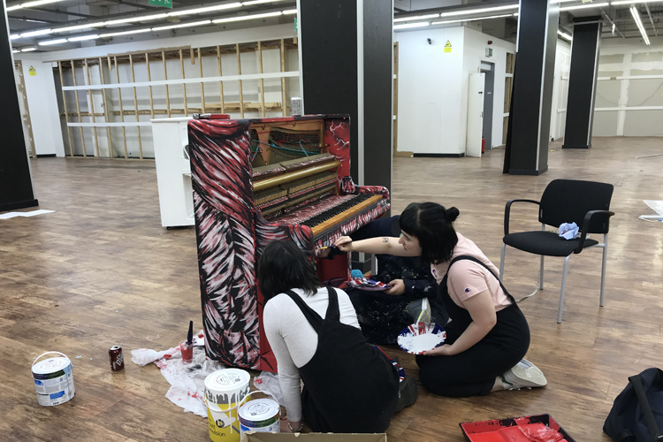 Fine Art students personalise piano ahead of installation