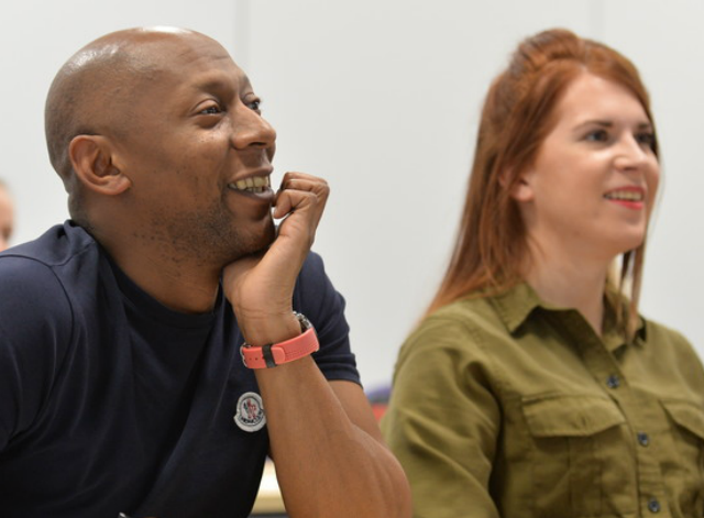 Two people attending a workshop