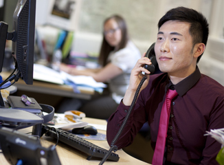 A staff member on the phone in an office