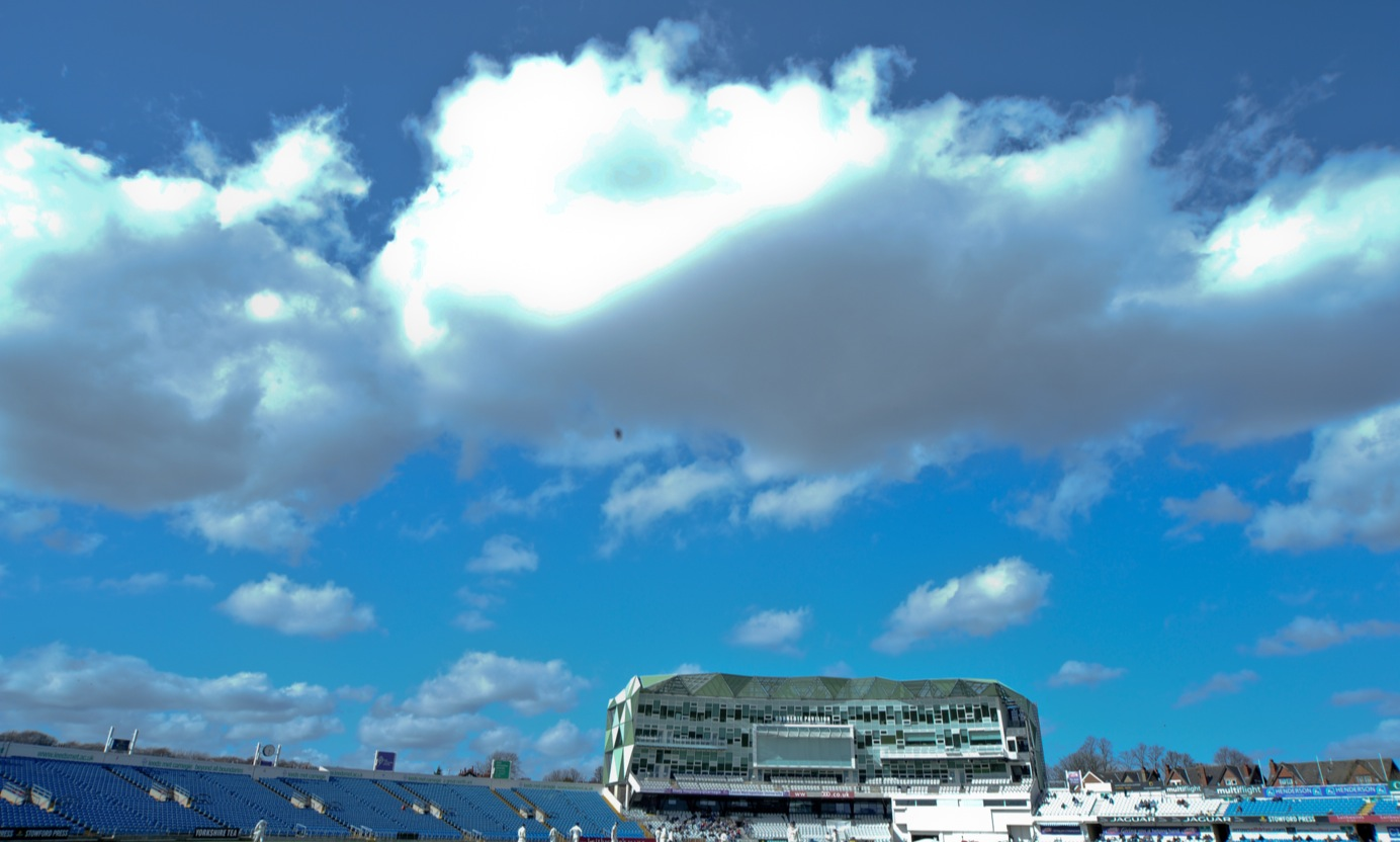 carnegie stadium with clouds and blue sky above