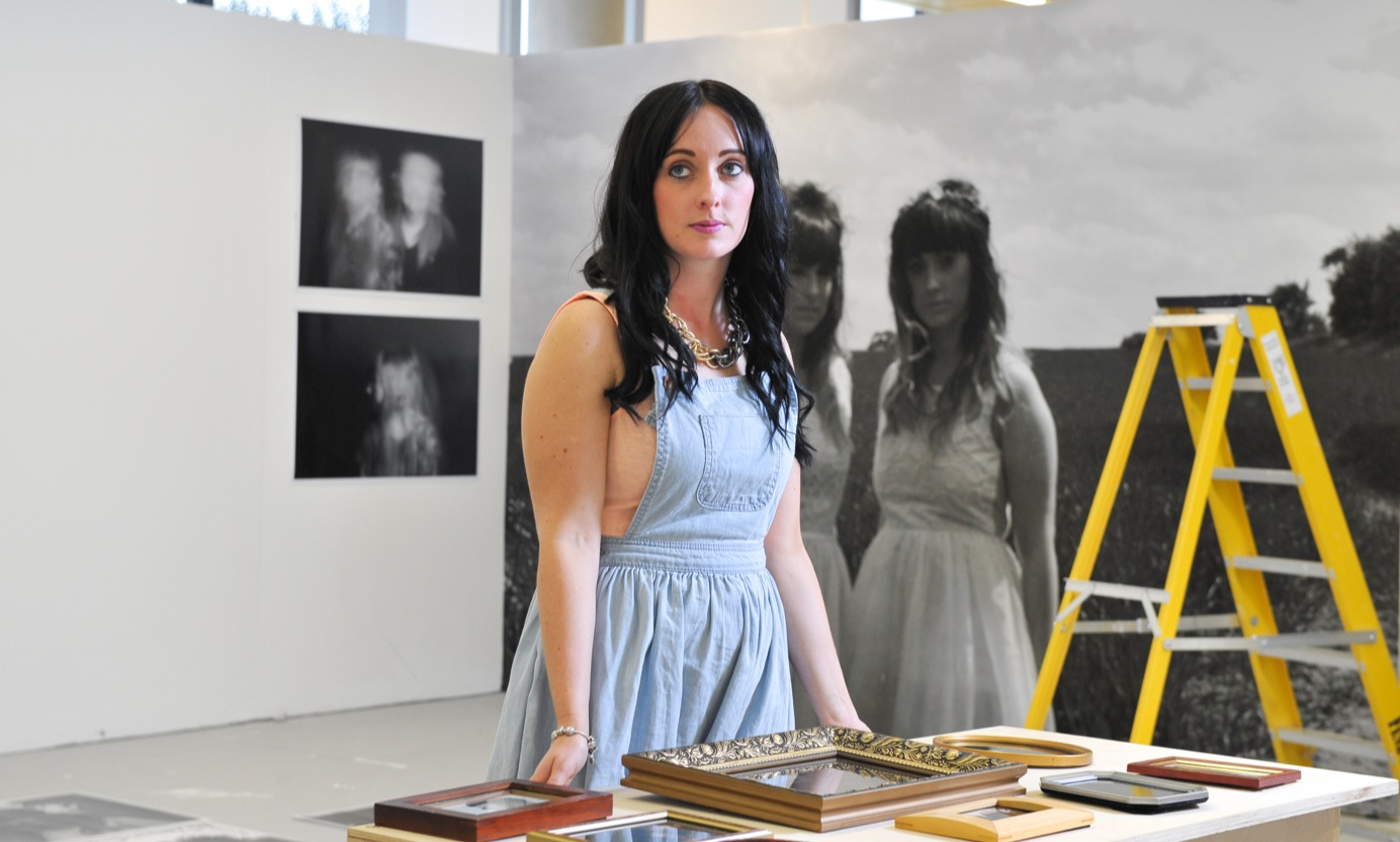 An art student setting up an exhibition