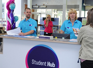 Two helpful members of staff at the Student Hub, Headingley campus