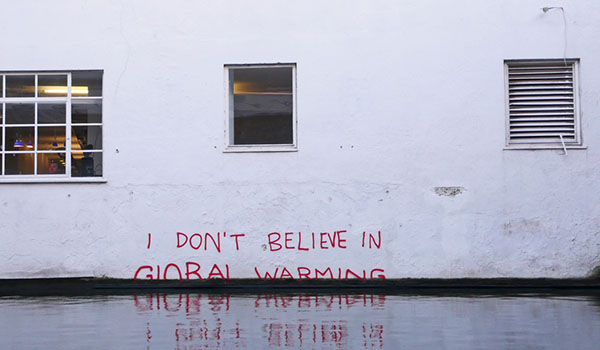 "Building with graffiti - ""I don't believe in global warming"""