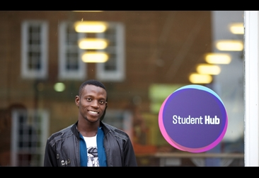 Student stood outside the student hub
