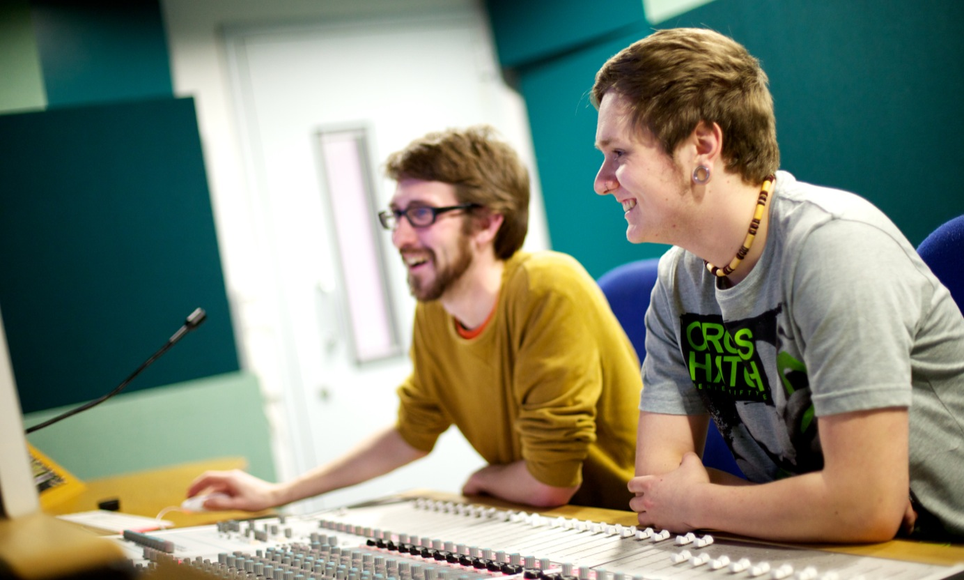Two students working in the audio studio