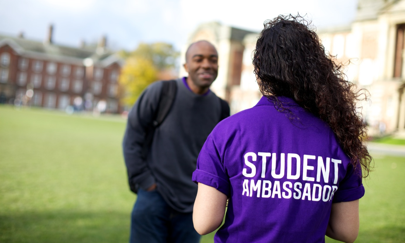 Student ambassador talking to another student