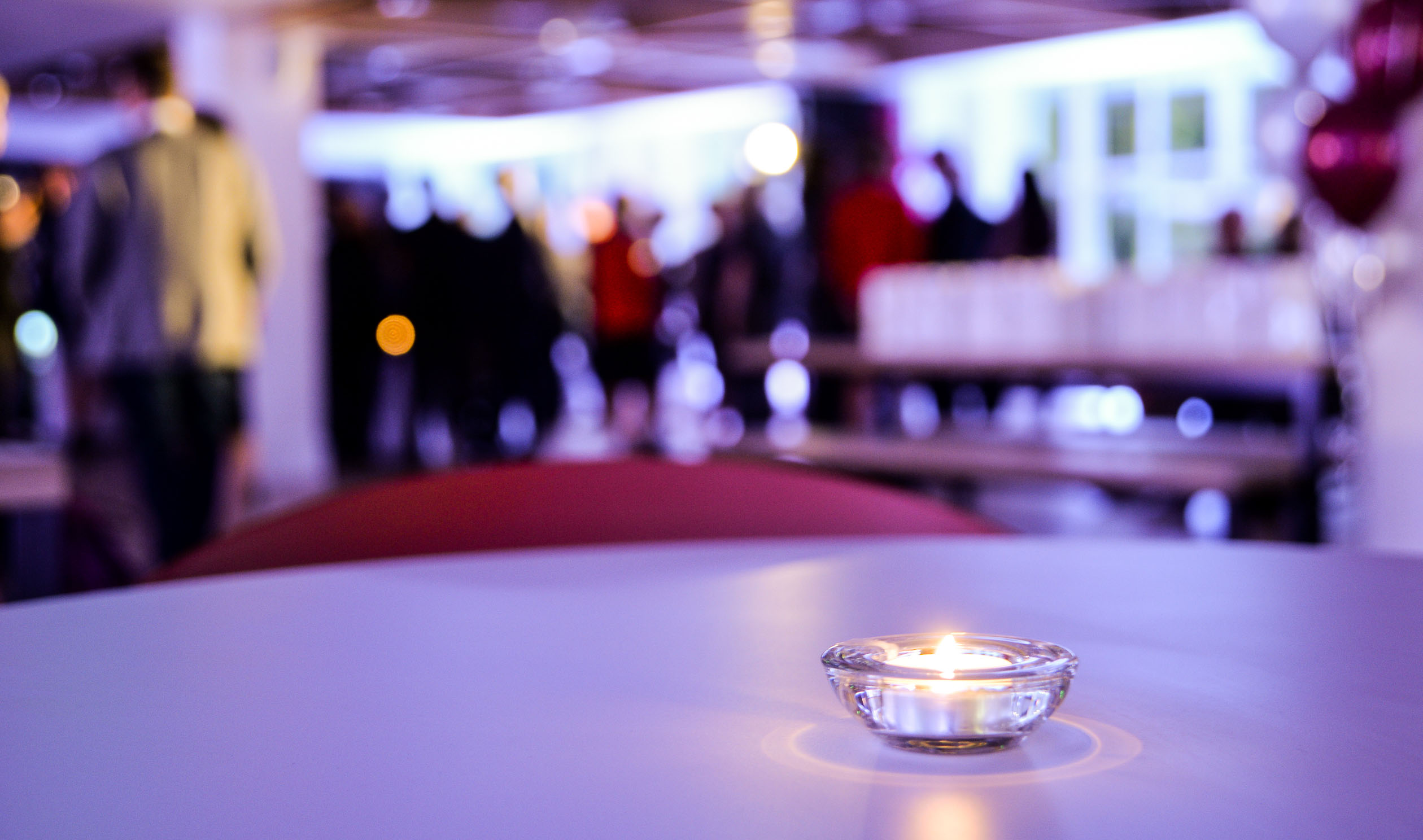 A candle on a table in Cloth Hall Court