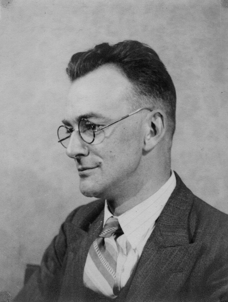 Black and white photo of man in glasses