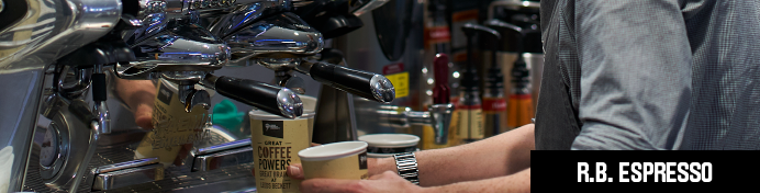 Barista is using a coffee machine