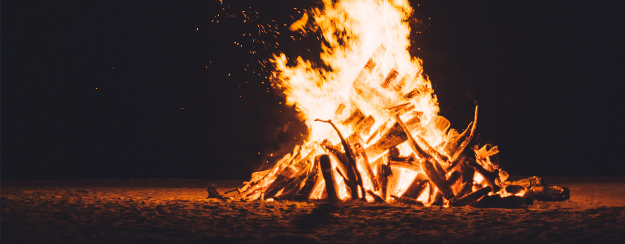 Bonfire lit in a dark night