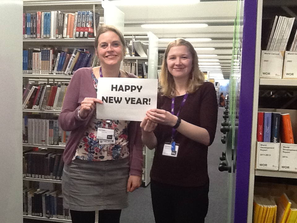 Sarah and Vicky holding Happy New Year sign