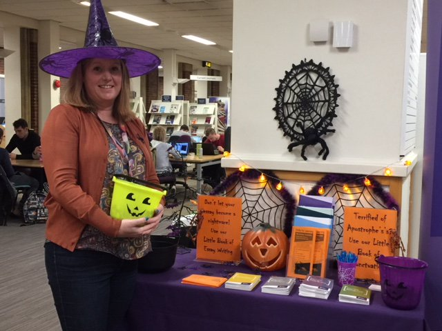 A member of the Library team wearing a witches hat