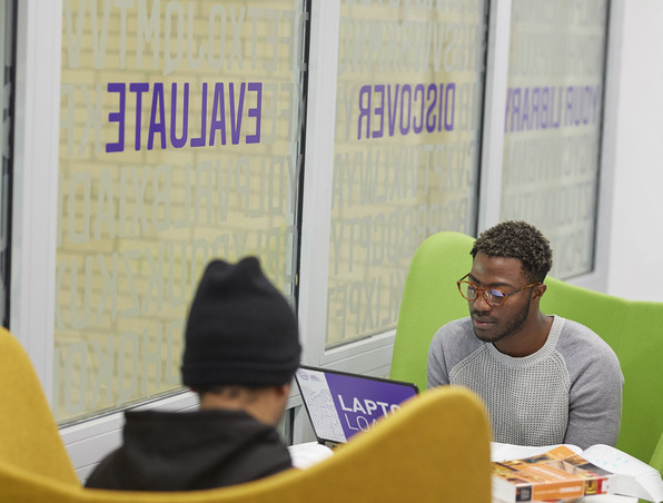 Students studying in groupd study area in the Library