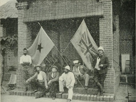 Old photo of men with flags