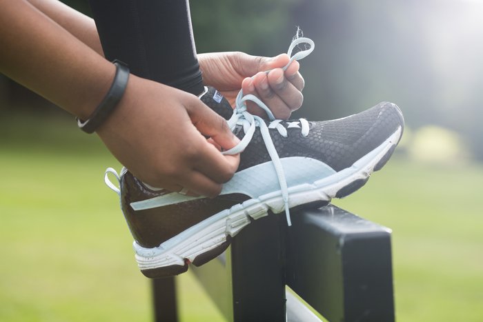 A running shoe being tied