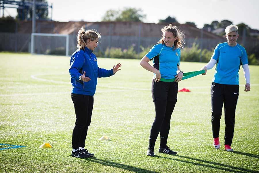 Women doing football training session