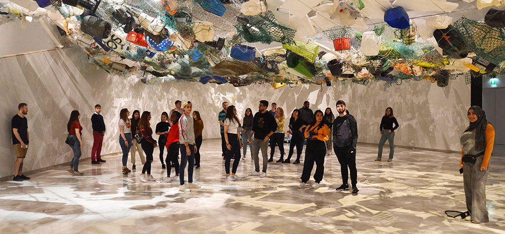 Students experiencing Tadashi Kawamatas Over Flow installation