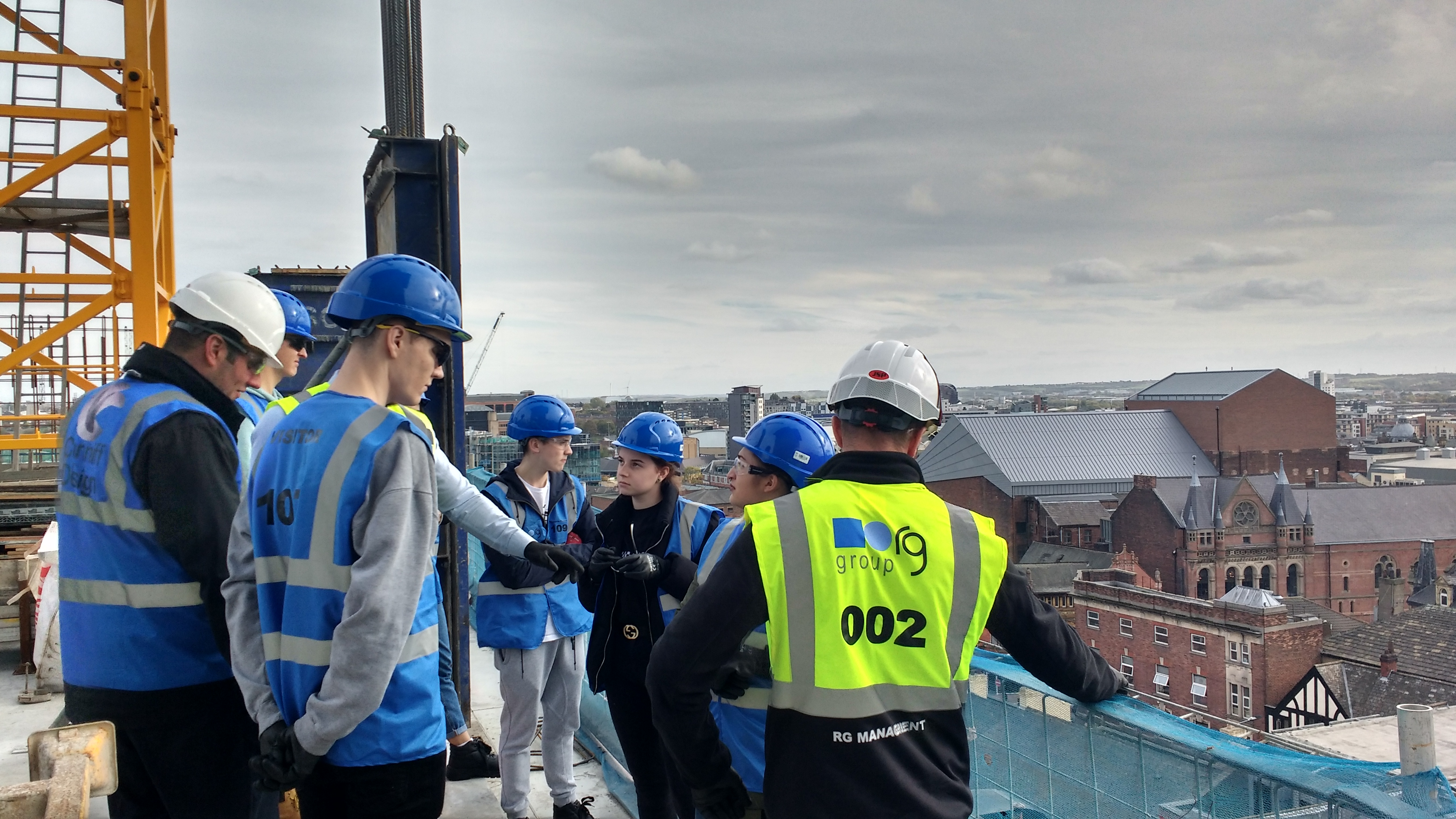 Students on the roof of new building