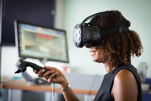 Women using VR game headset and controller