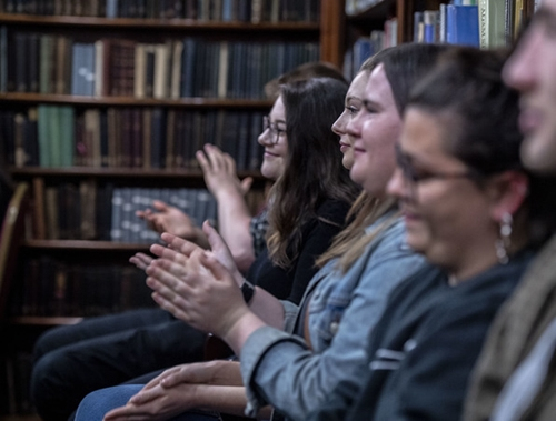 Audience clapping in the library