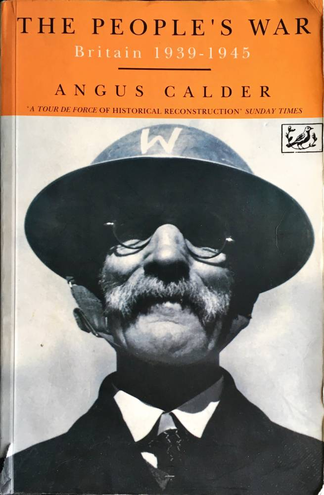 Front cover of 'The People's War' by Angus Calder, with a WW2 home guard warden on the front - a man with a moustache, glasses and a helmet with a W on the front