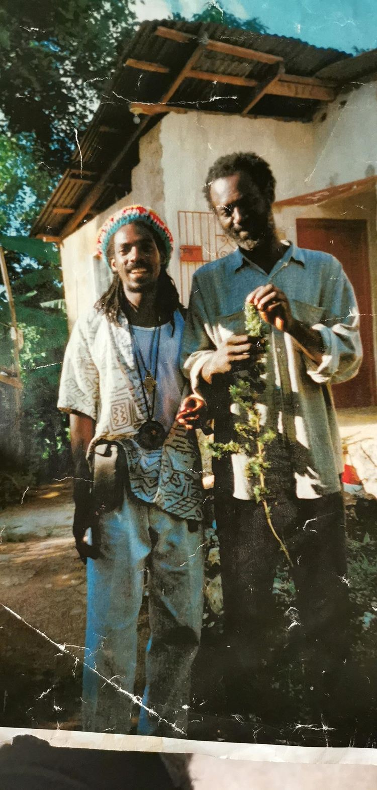 Derrick and his son in Law Paul back visiting Home, Jamaica in the 90's