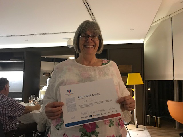 Ruth holding her award certificate