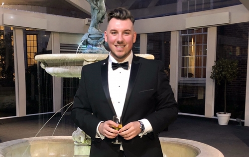 Leeds Law School student Bradley Graves dressed in tux at law event.