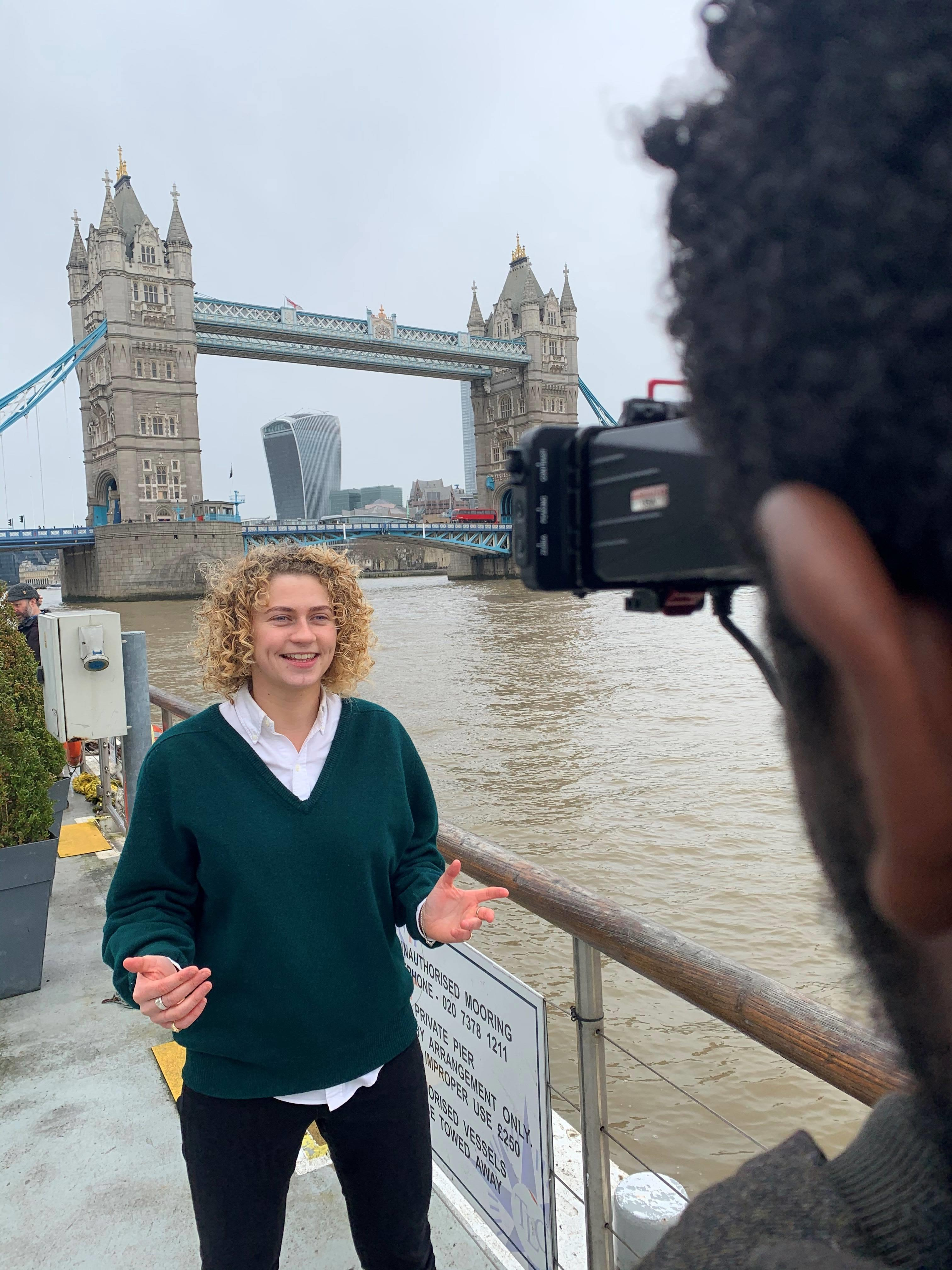 connie on camera in front of london bridge