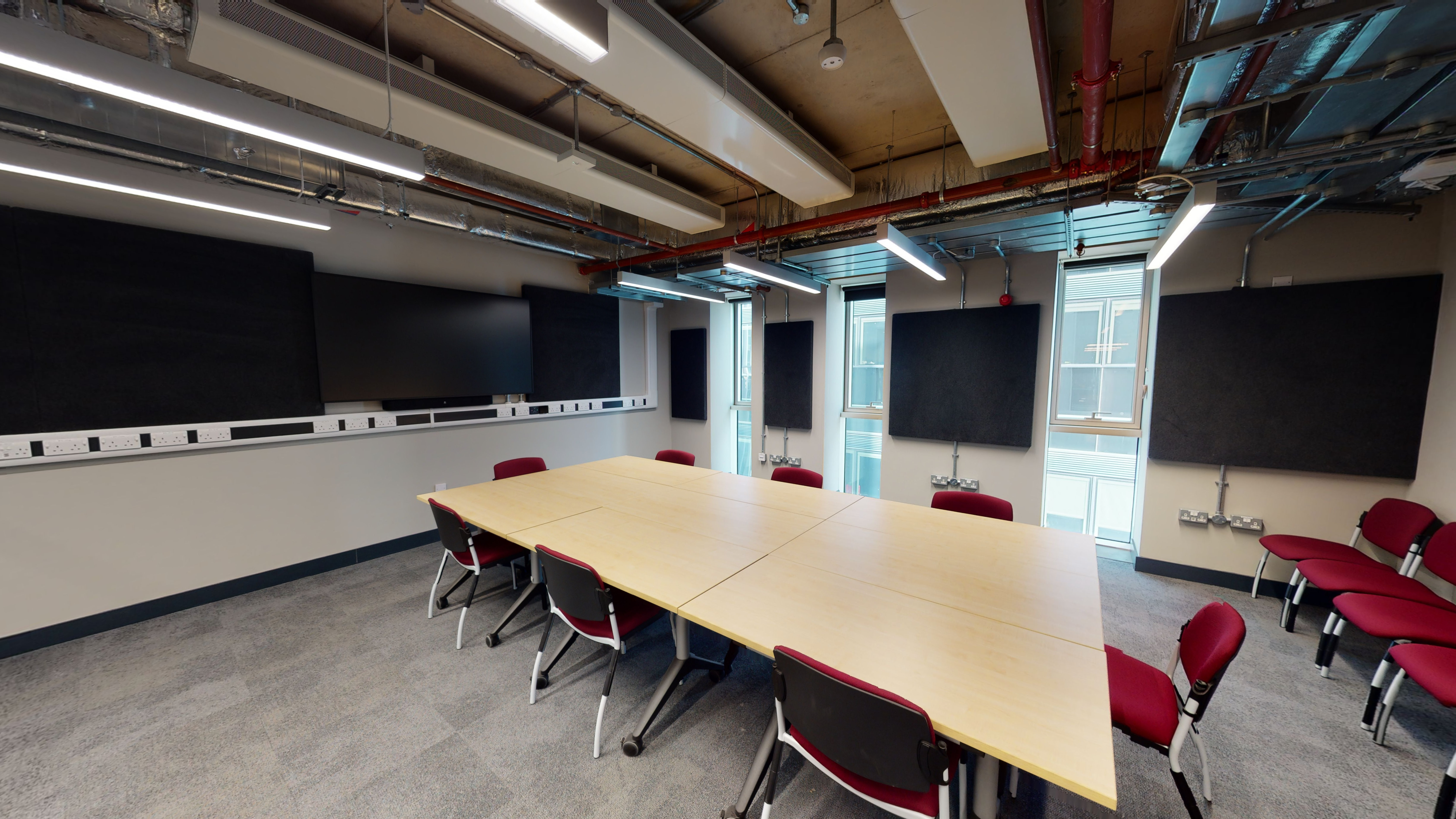 Large office style space with a large table and seating for 10+ people.