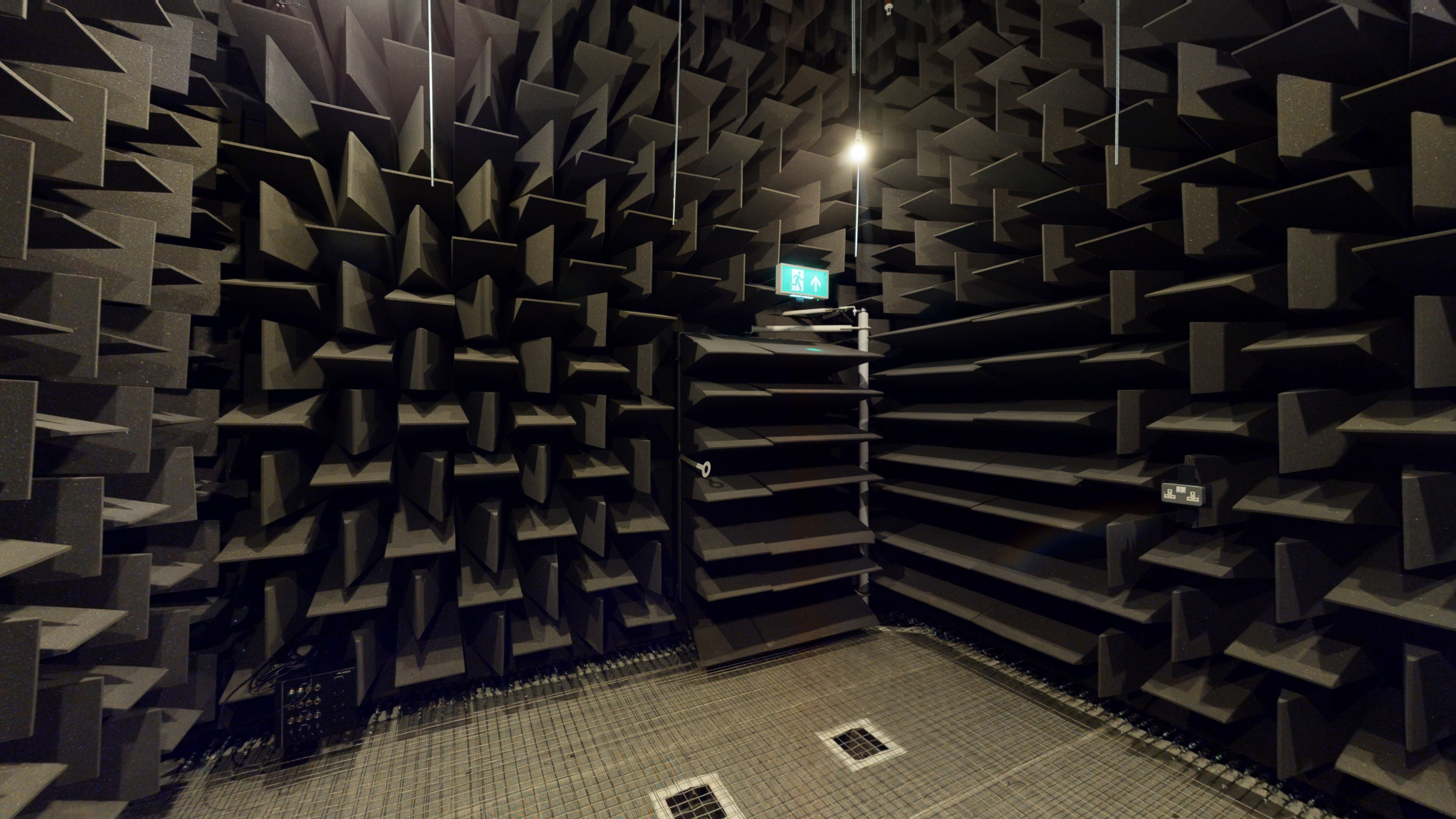 Chamber style room with every wall and the ceiling covered in wedged pieces of sound insulating foam.