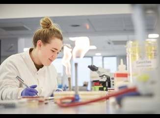 Student in Leeds Beckett's Biomedical Science labs