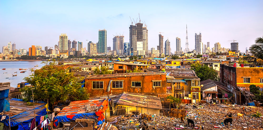 Slums in front of a modern city