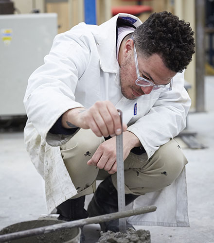 Researcher testing concrete
