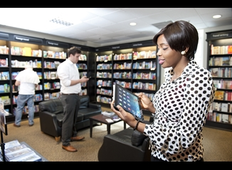 Lady using a tablet in book store