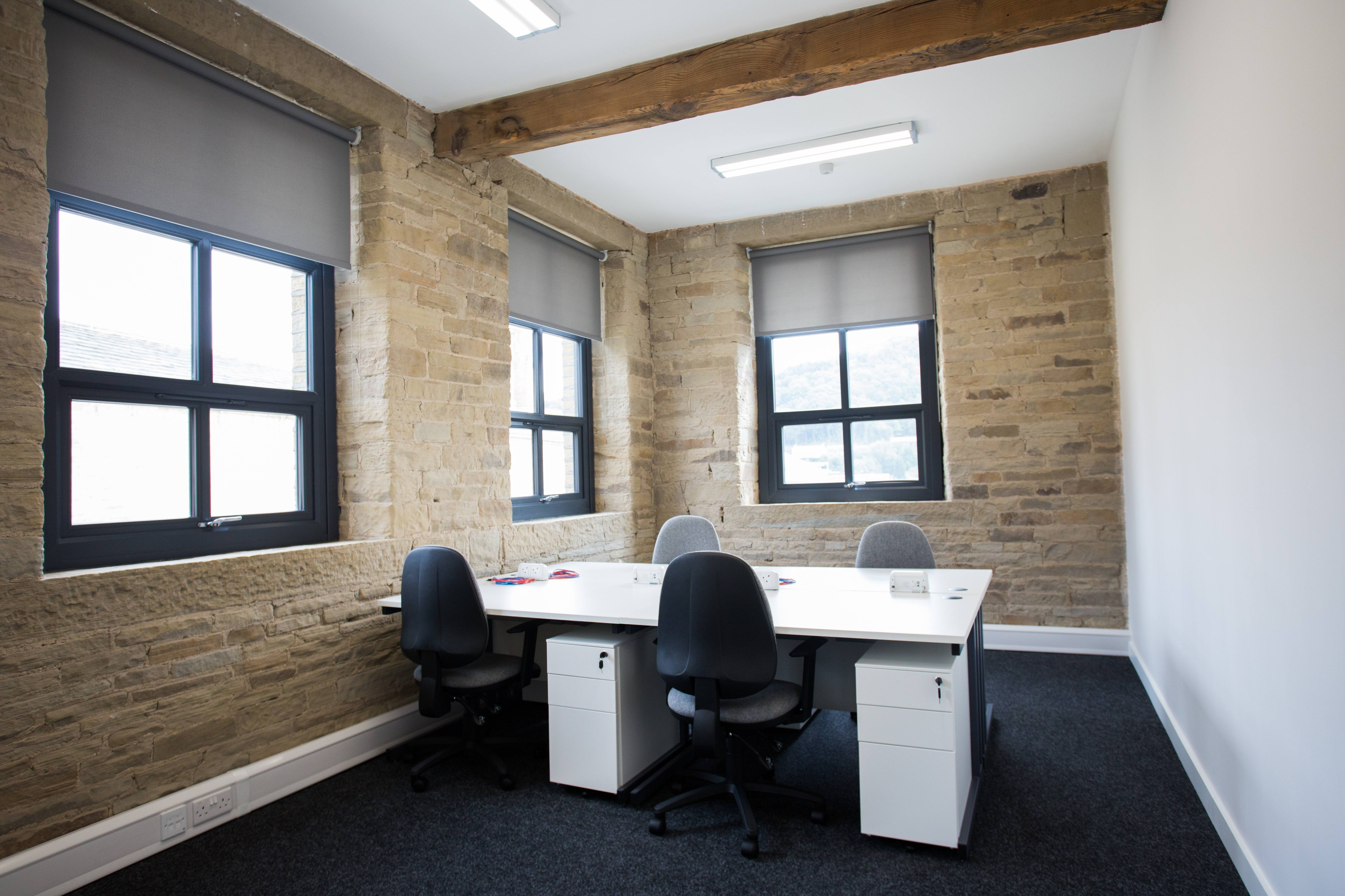 Office space/meeting room for four people.