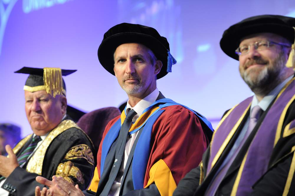 Honorary Doctorate of the University, Jason Gillespie sits between Chancellor Sir Bob Murray and Deputy Vice Chancellor Professor Phil Cardew.
